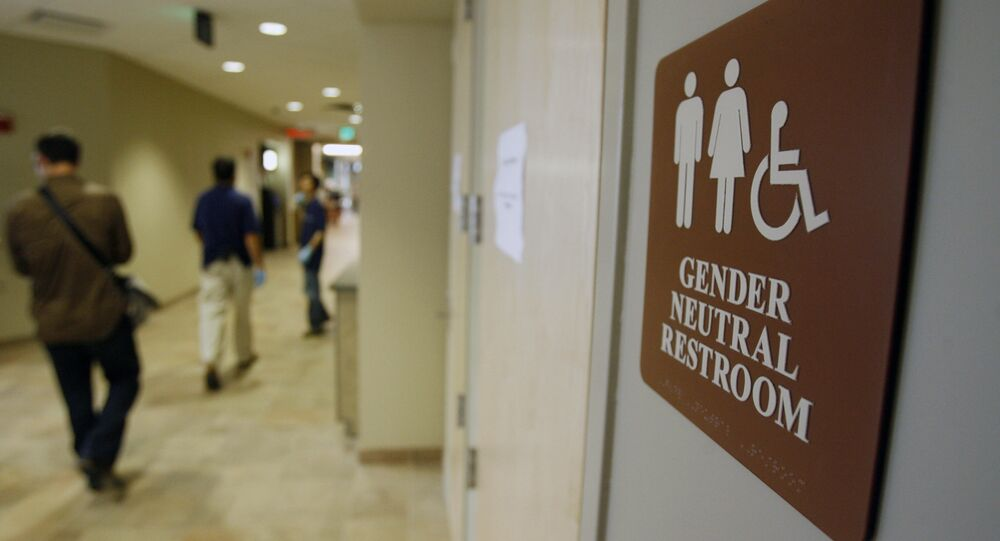 In this Aug. 23, 2007 file photo, a sign marks the entrance to a gender neutral restroom at the University of Vermont in Burlington, Vt.