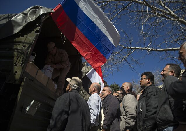 Local residents line up to get a food aid from a Russian military truck (file)