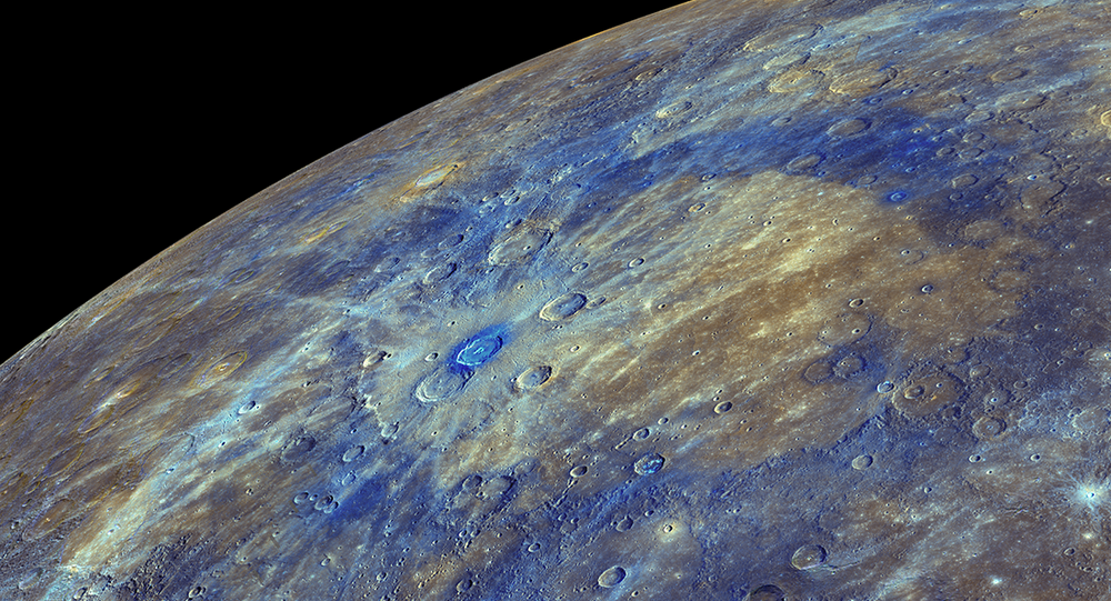 An enhanced-color image of Mercury, highlighting the carbon-rich material associated with impact craters