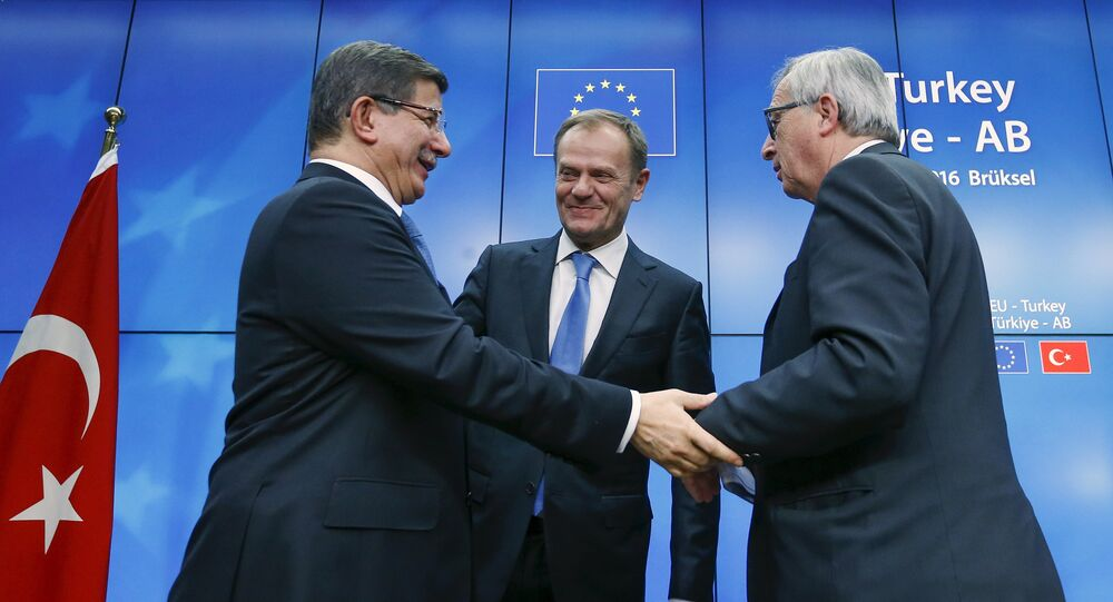 Turkish Prime Minister Ahmet Davutoglu (L), European Council President Donald Tusk (C) and European Commission President Jean Claude Juncker (R) greet each other after a news conference at the end of a EU-Turkey summit in Brussels March 8, 2016