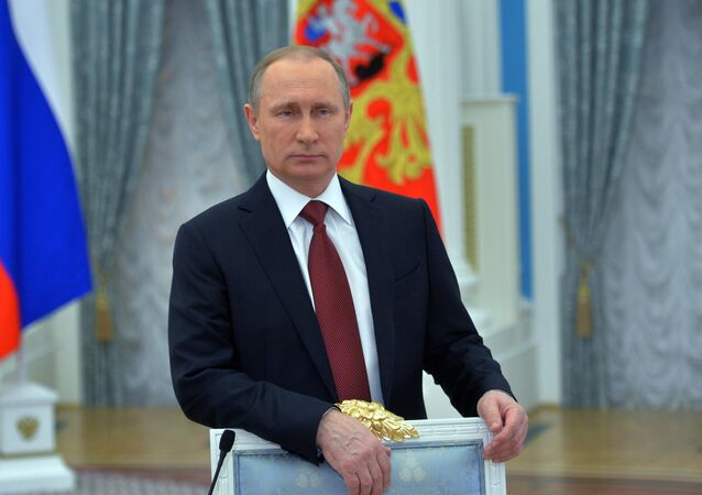 Russian President Vladimir Putin delivers a message of congratulation to Russian women on the International Women's Day