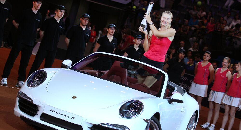 Russia's Maria Sharapova stands in the Porsche Carrera she won after beating Belarus' Victoria Azarenka 6-1, 6-4 in the final of the Porsche Tennis Grand Prix in Stuttgart, Germany, Sunday, April 29, 2012