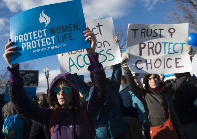 Supporters of legal access to abortion rally outside the Supreme Court in Washington, DC, March 2, 2016, as the Court hears oral arguments in the case of Whole Woman's Health v. Hellerstedt, which deals with access to abortion