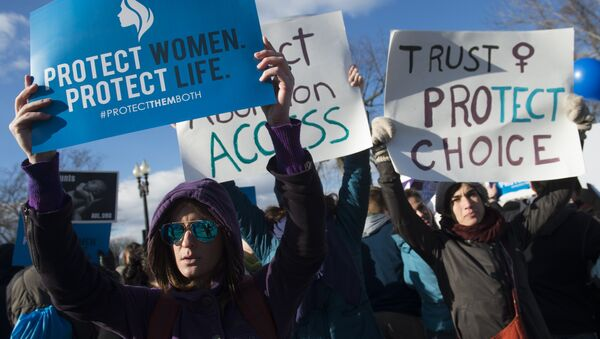Supporters of legal access to abortion rally outside the Supreme Court in Washington, DC, March 2, 2016, as the Court hears oral arguments in the case of Whole Woman's Health v. Hellerstedt, which deals with access to abortion - Sputnik International
