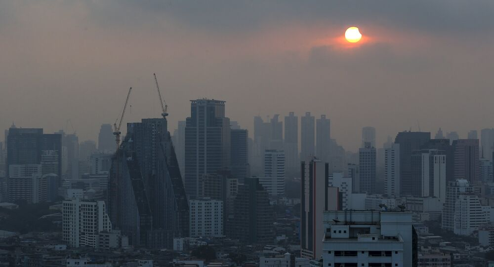 A partial solar eclipse is seen in Bangkok, Thailand, March 9, 2016.