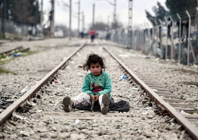 A child plays on a rail track at the Greek-Macedonian border near the village of Idomeni where thousands of migrants and refugees are stranded on March 7, 2016.