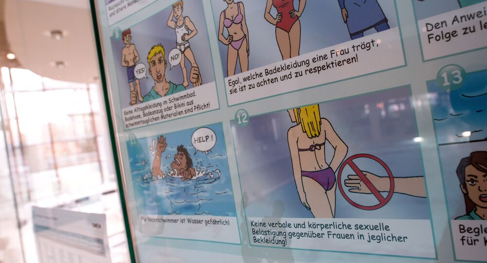 A poster informs about pool rules in a public swimming pool in Munich, southern Germany, on January 12, 2016.
