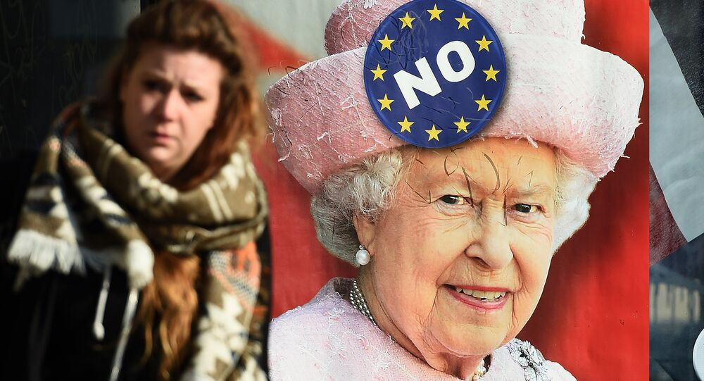 A combo picture made and taken on February 29, 2016 in Brussels shows two women walking by a bus stop with an advertisement campaign for a Belgium radio news channel picturing British Queen Elizabeth II with a logo reading No on her hat .