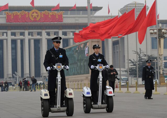 Police patrol outside the Great Hall of the People before the opening session at the 11th National Committee of the Chinese People's Political Consultative Conference (CPPCC) in Beijing on March 3, 2012.