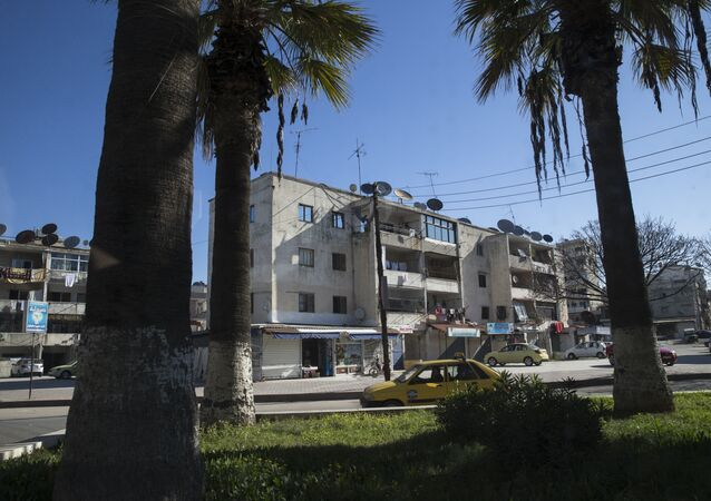 In this photo taken on Tuesday, March 1, 2016, a car passes on a street in Latakia, Syria. Associated Press spent five days traveling through the port of Latakia in Syria during the ceasefire.