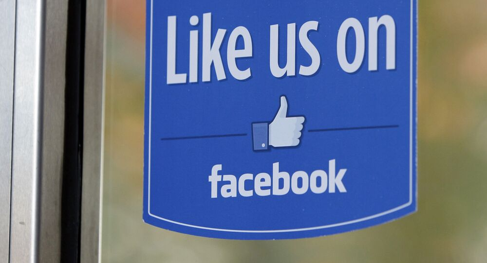 FILE - In this Dec. 13, 2011 file photo, a sign with Facebook's Like logo is posted at Facebook headquarters near the office for the company's User Operations Safety Team in Menlo Park, Calif.