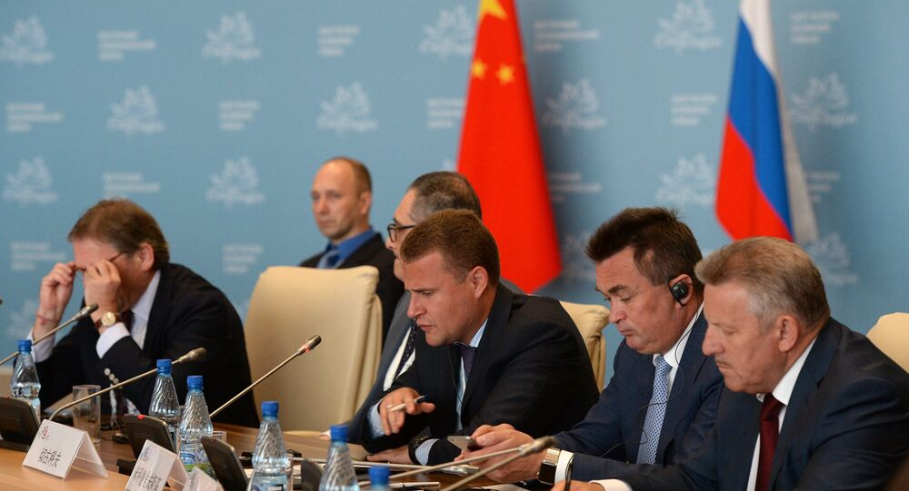 Alexei Chekunkov (center), CEO, JSC Far East and Baikal Region Development Fund, attends the Country Dialogue Russia-China at the Eastern Economic Forum in Vladivostok