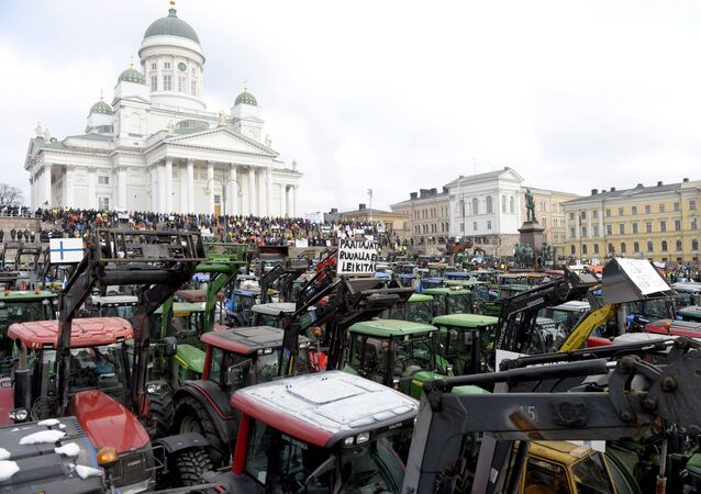 Farmers from different parts of Finland with their tractors participate in a demonstration over declining agricultural earnings in Helsinki, Finland, March 11, 2016.