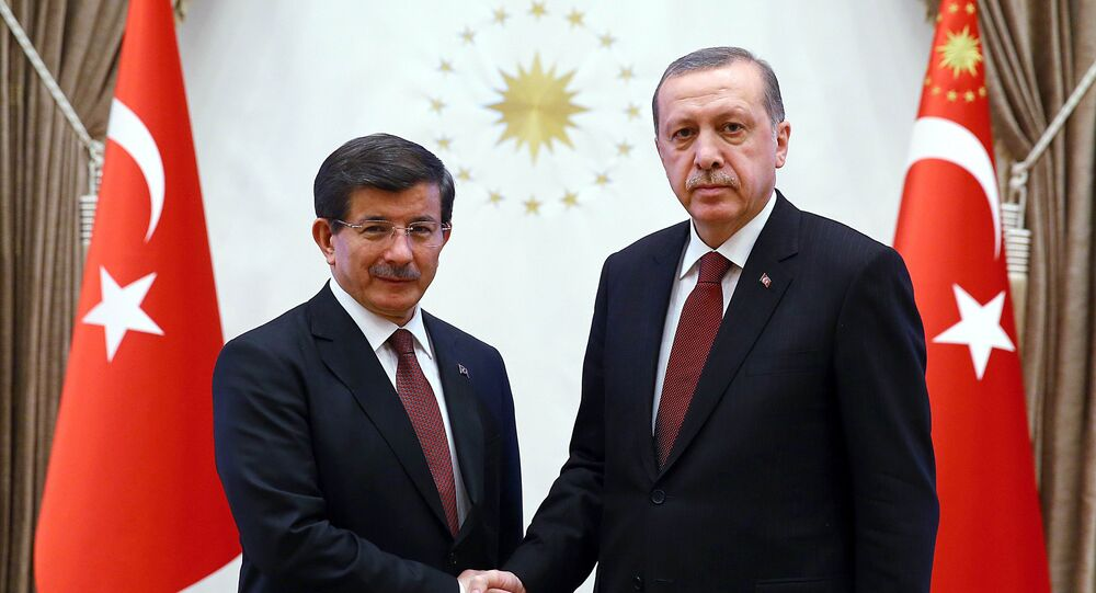 A handout image made available by the Turkish Presidential Press Office on January 29, 2015, shows Turkish President Recep Tayyip Erdogan (R) shaking hands with Turkish Prime Minister Ahmet Davutoglu at Presidential Palace in Ankara.