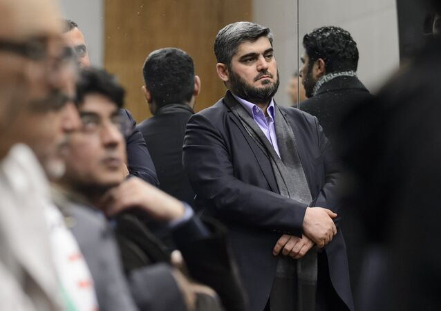 Chief negotiator for the main Syrian opposition body and rebel group Army of Islam, Mohammed Alloush (C) stands during a press conference after Syrian peace talks on February 3, 2016 in Geneva. (File)