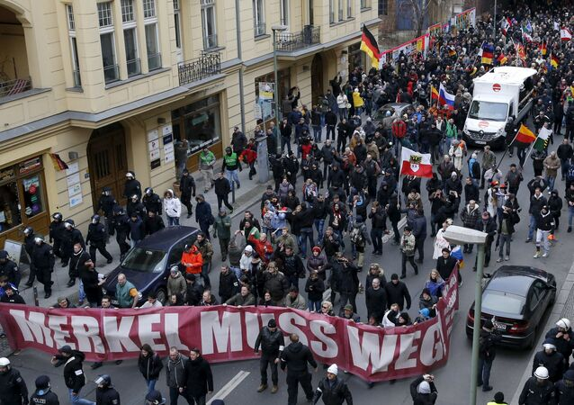 Far right-wing supporters march during rally against the German government's immigration policies and migrants, near-by the Chancellery in Berlin, Germany.