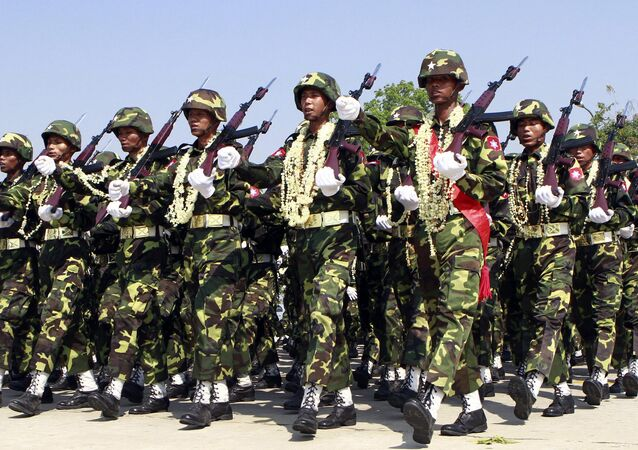 In this photo taken on March. 27, 2012, Myanmar soldiers march during a ceremony to mark the country's 67th Armed Forces Day in Naypyitaw, Myanmar