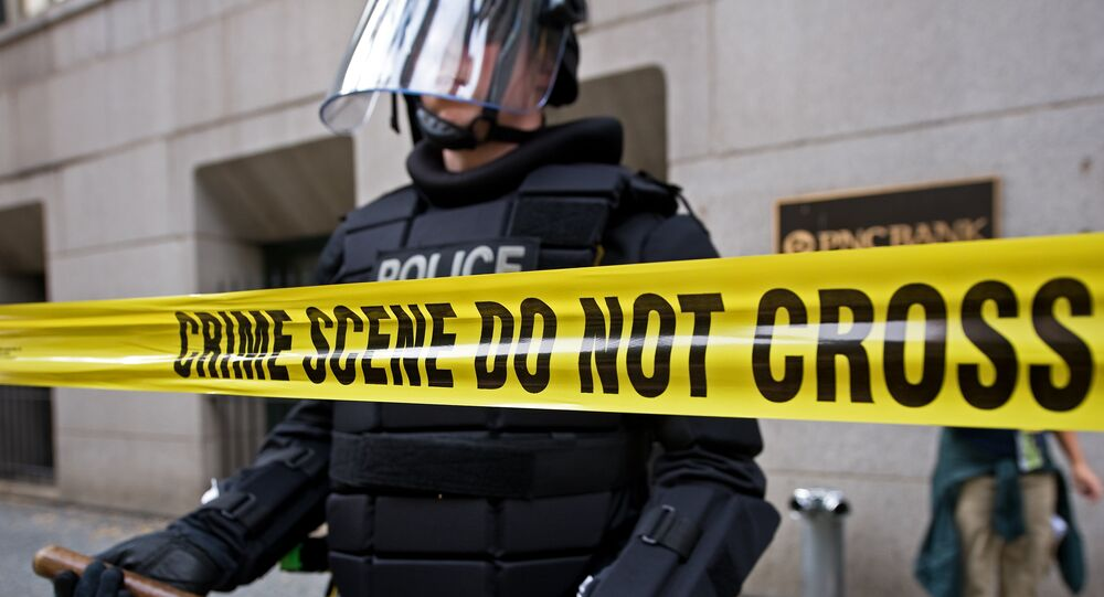 A policeman in riot gear is positioned on a steet during protests in downtown Pittsburgh, Pennsylvania. File photo