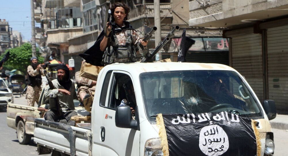 Fighters from Al-Qaeda's Syrian affiliate Al-Nusra Front drive in armed vehicles in the northern Syrian city of Aleppo as they head to a frontline, on May 26, 2015