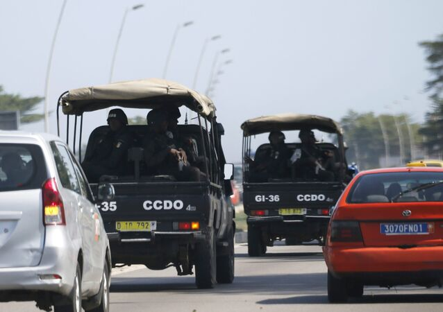 Security forces drive towards Grand Bassam in Abidjan, Ivory Coast, March 13, 2016