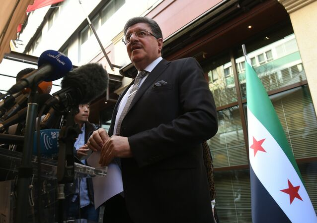 High Negotiations Committee (HNC) spokesman Salem al-Meslet speaks during a press conference on the eve of the second round of Syrian peace talks in Geneva on March 13, 2016