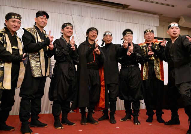 Governors and mayors from Mie, Shiga, Kanagawa prefecture and former tourism agency chief Hiroshi Mizohata (R) pose in ninja costumes for photos as they hold a press conference in Tokyo on March 8, 2015