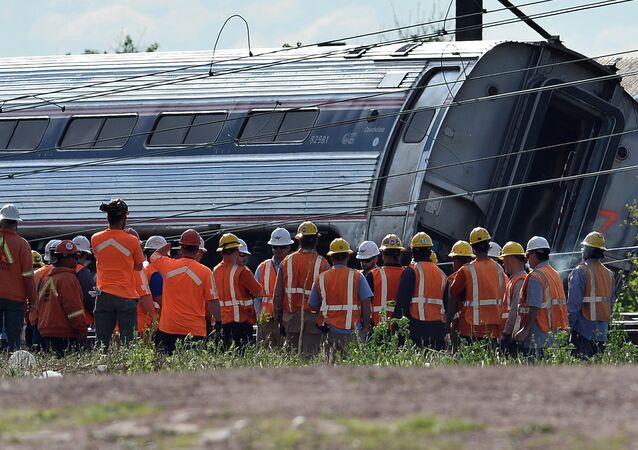 Rescuers gather around a derailed carriage of an Amtrak train in Philadelphia, Pennsylvania, on May 13, 2015 file photo
