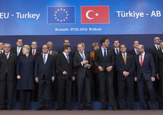 Turkish Prime Minister Ahmet Davutoglu (C) poses with European Union leaders during a EU-Turkey summit in Brussels, as the bloc is looking to Ankara to help it curb the influx of refugees and migrants flowing into Europe, March 7, 2016