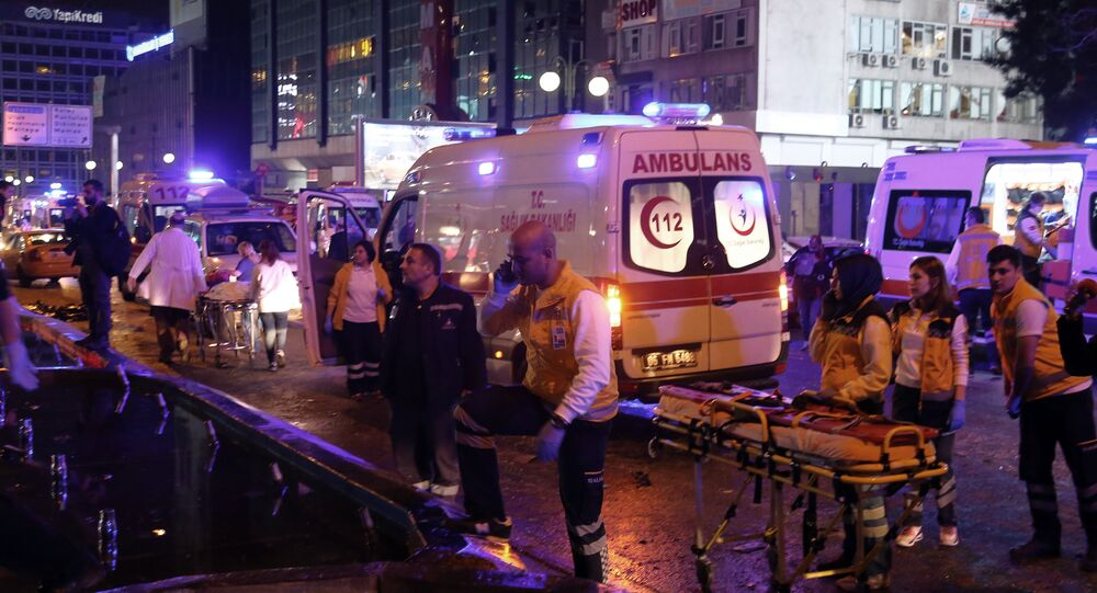 Emergency services work at the explosion site in the busy center of Turkish capital, Ankara, Turkey, Sunday, March 13, 2016