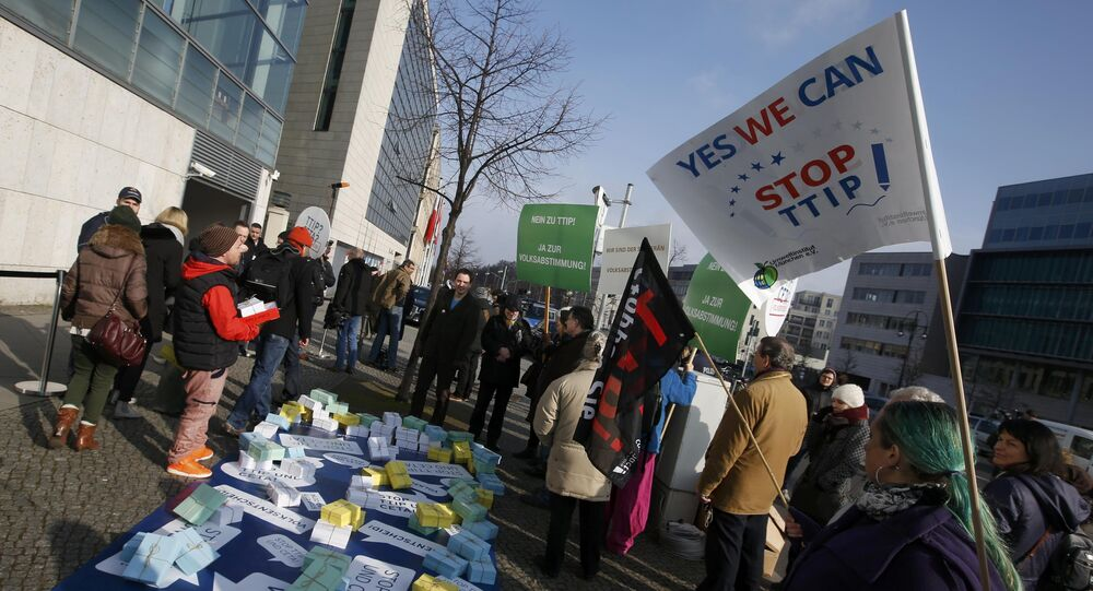 Opponents of the Transatlantic Trade and Investment Partnership (TTIP) protest outside the headquarters of the Christian Democratic Union (CDU) in Berlin, Germany, March 14, 2016