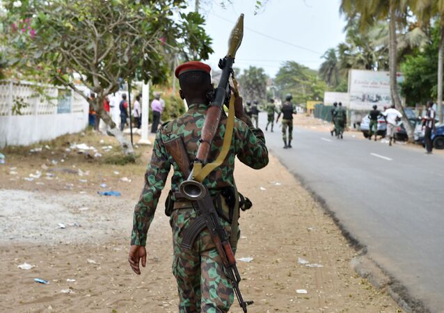 An armed soldier patrols in the streets of Grand Bassam, Ivory Coast, on March 14, 2016, a day after jihadist attackers stormed three hotels in the weekend resort. Ivory Coast ministers were to hold emergency talks on March 14 after the first jihadist attack in the country left 18 dead at a beach resort popular with foreigners, the latest such Islamist assault in West Africa