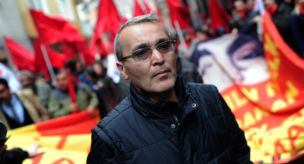 Berkin Elvan's father Sami Elvan marches in Istanbul on March 7, 2015 as thousands of people marched to mark the first anniversary of the death of the youngest victim of the Gezi Park protests