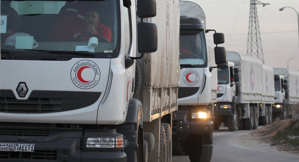 A Syrian Arab Red Crescent aid convoy heads towards the villages of al-Foua and Kefraya in Idlib province, Syria February 17, 2016