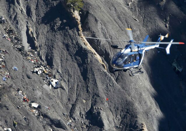 A French Gendarmerie rescue helicopter flies over the debris of the Germanwings Airbus A320 at the site of the crash, near Seyne-les-Alpes, France, in this picture taken on March 27, 2015. French BEA air accident investigators reported March 13, 2016 that a doctor had recommended that the German pilot who crashed a Germanwings jet into the Alps last year should be treated in a psychiatric hospital two weeks before the disaster