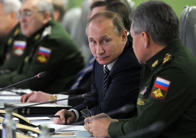Russian President Vladimir Putin, second right, speak with Russian Defense Minister Sergei Shoigu, right, as he attends a meeting with top military and leaders of military industry in the Defense Ministry in in Moscow, Russia, Friday, March 11, 2016