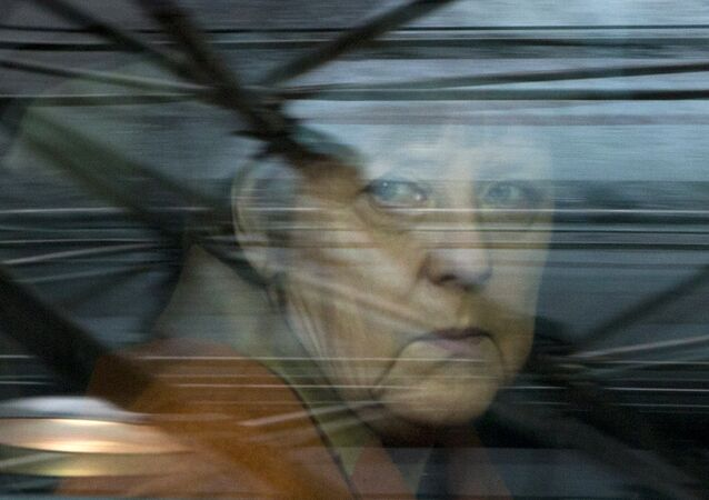 German Chancellor Angela Merkel looks out of her car window as she arrives for an EU summit at the EU Council building in Brussels on Monday, March 7, 2016