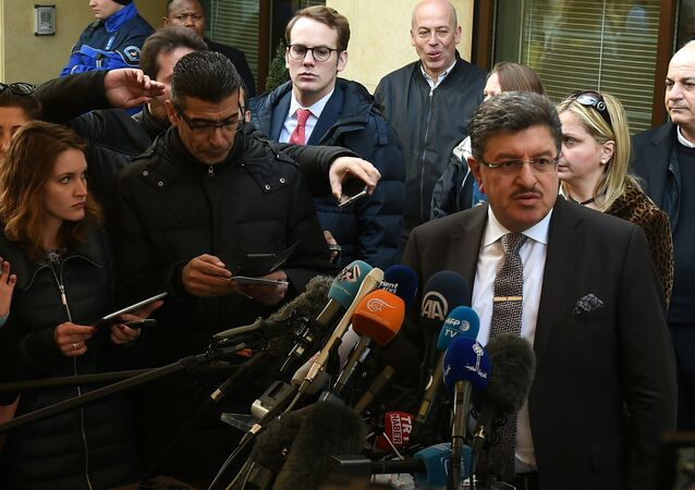 High Negotiations Committee (HNC) spokesman Salem al-Meslet (R) addresses the media during a press conference on the eve of the second round of Syrian peace talks in Geneva on March 13, 2016