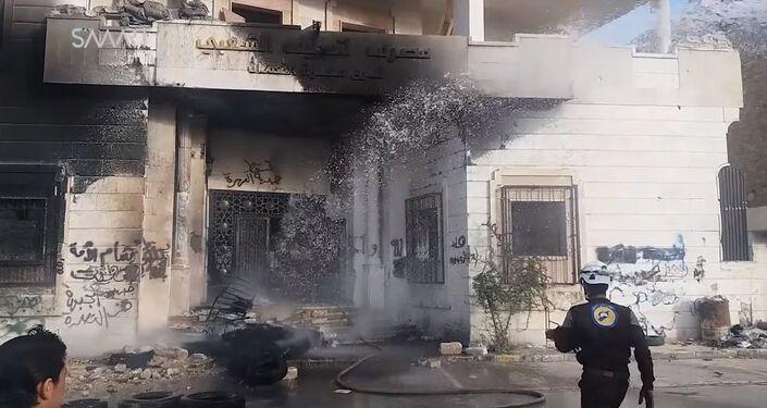 Burnt headquarters of al-Nusra Fron in Maarat al-Numa