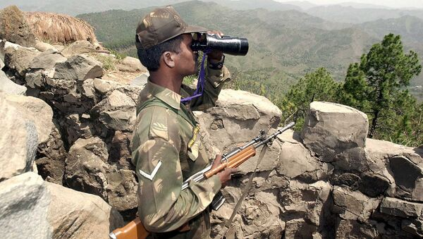 An Indian soldier looks through binoculars at a forward post somewhere in Mendhar sector 200 meters from the Line of Control separating Indian and Pakistan held Kashmir, some 100 Kms southwest of Srinagar (File) - Sputnik International