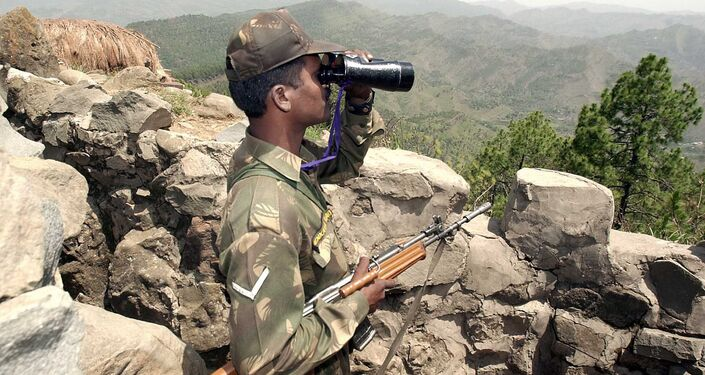 An Indian soldier looks through binoculars at a forward post somewhere in Mendhar sector 200 meters from the Line of Control separating Indian and Pakistan held Kashmir, some 100 Kms southwest of Srinagar (File)