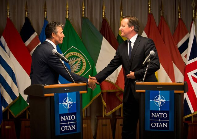 UK PM David Cameron (right) and former Secretary General of NATO Anders Fogh Rasmussen