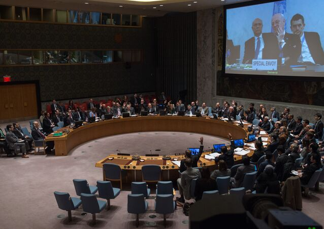 Staffan de Mistura, U.N. special envoy for Syria, is displayed on a video screen via video conference from Geneva, as the United Nations Security Council votes to support a resolution endorsing a cease-fire in Syria, Friday, Feb. 26, 2016 at United Nations headquarters