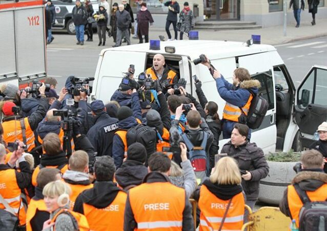 The arrest of journalist Graham Phillips at SS veterans' march in Riga, Latvia. March 16, 2016.