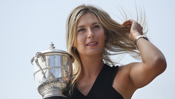 Russia's Maria Sharapova poses with the Suzanne Lenglen trophy in Paris on June 8, 2014 a day after winning the Roland Garros French Tennis Open - Sputnik International