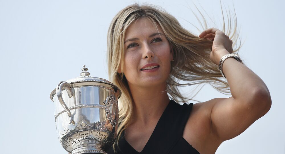 Russia's Maria Sharapova poses with the Suzanne Lenglen trophy in Paris on June 8, 2014 a day after winning the Roland Garros French Tennis Open