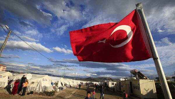 Turkish flag flies at the refugee camp for Syrian refugees in Islahiye, Gaziantep province, southeastern Turkey,Wednesday, March 16, 2016 - Sputnik International