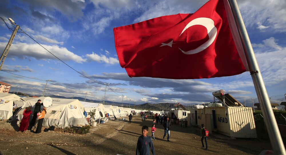 Turkish flag flies at the refugee camp for Syrian refugees in Islahiye, Gaziantep province, southeastern Turkey,Wednesday, March 16, 2016