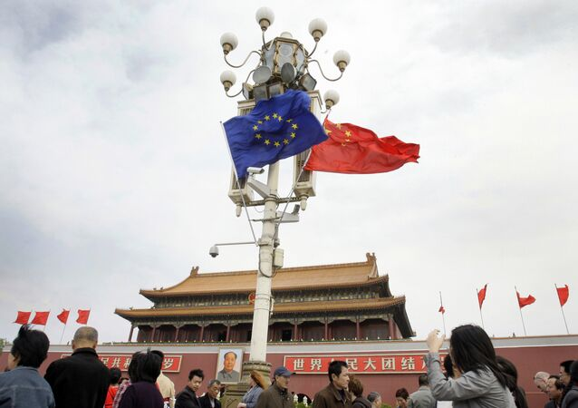 Visitors walk under flags of European Union and China in front of The Tiananmen Gate in Beijing (File)