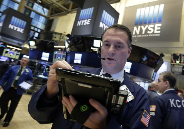 Trader Jonathan Corpina works on the floor of the New York Stock Exchange, Wednesday, March 16, 2016