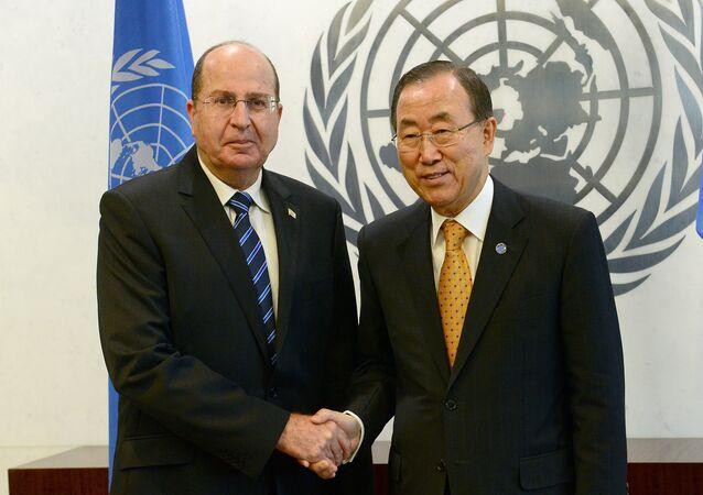 UN Secretary-General Ban Ki-moon (R) greets Israel's Defense Minister Moshe Ya'alon